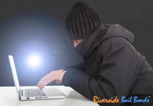 hacker-working-with-a-laptop-computer-in-the-darkness (1)